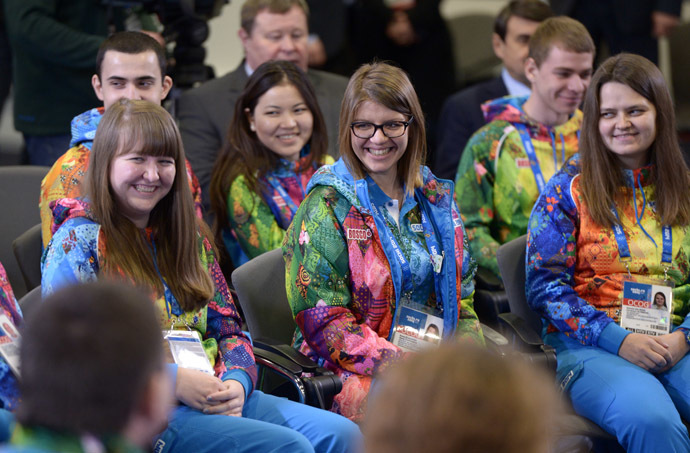 Volunteers taking part in preparing and holding the 22nd Winter Olympic Games and 11th Winter Paralympic Games in Sochi, at a meeting with President Vladimir Putin. (RIA Novosti/Aleksey Nikolskyi)