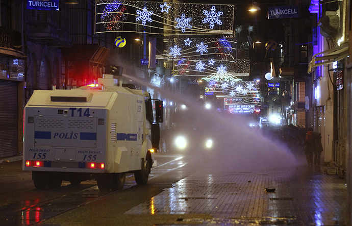 Riot police use a water cannon to disperse demonstrators during a protest against internet censorship in Istanbul January 18, 2014. (Reuters / Osman Orsal)