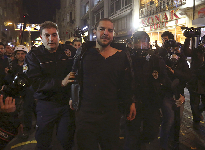 Riot policemen detain a demonstrator during a protest against internet censorship in Istanbul January 18, 2014. (Reuters)