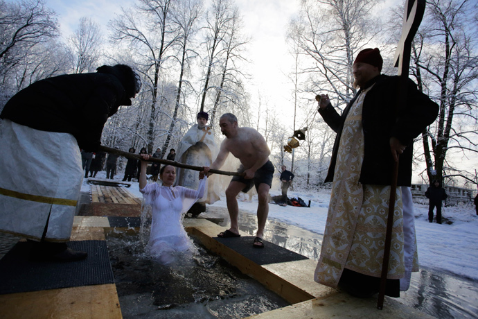 A Russian Orthodox Christian takes a dip in an icy pond during Orthodox Epiphany celebrations in the village of Strelna outside St. Petersburg January 19, 2014. (Reuters / Maxim Zmeyev)