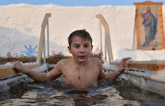 A boy dives in an ice hole during Epiphany bathing in Tobolsk. (RIA Novosti / Alexey Malgavko)