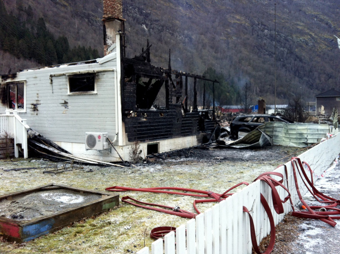 Burnt debris of a house are pictured at the site where a fire destroyed many of the famed 18th- and 19th-century wooden houses in the village Laerdal, southern Norway, on January 19, 2014. (AFP Photo / NTB / Marit Hommedal Norway out)