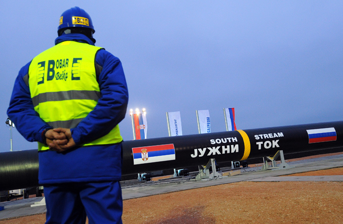 A construction worker standing in front of the Serbian stretch of Russia's South Stream gas pipeline near the village of Sajkas, 80 kilometres north of Serbian capital Belgrade (AFP Photo)