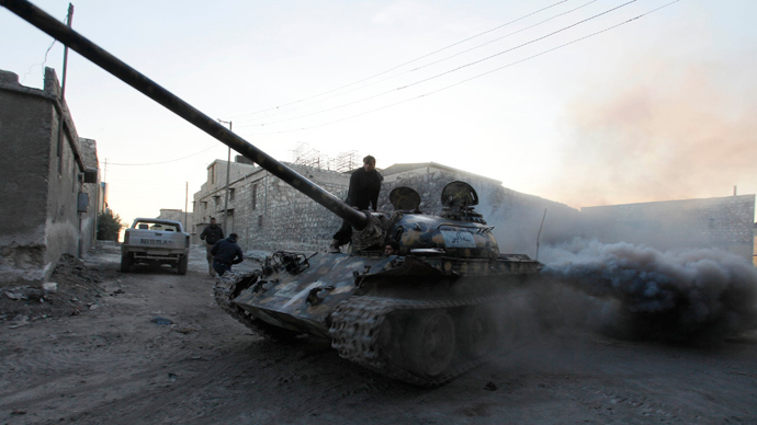 A Free Syrian Army tank drives through a street in Aleppo November 30, 2013 (Reuters / Molhem Barakat)