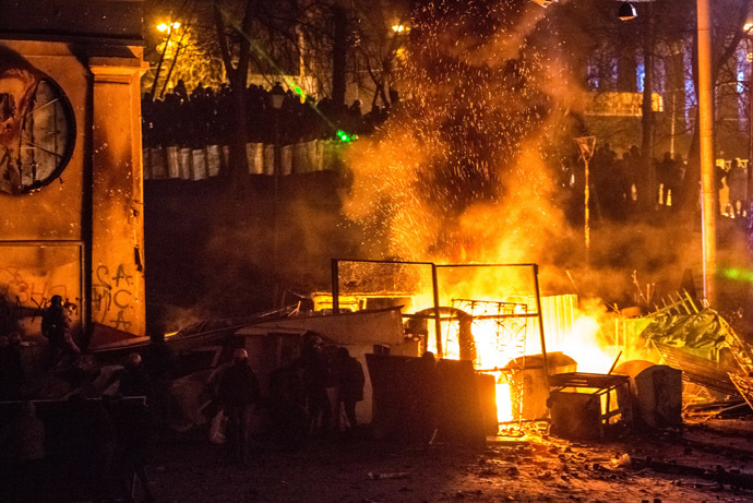 Fires burn during major clashes of protesters with law enforcement officials at Dynamo stadium in Kiev. (RIA Novosti/Andrey Stenin)
