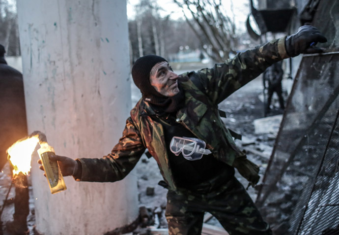 A protester throws a Molotov cocktail at Dynamo stadium in Kiev. (RIA Novosti/Andrey Stenin)
