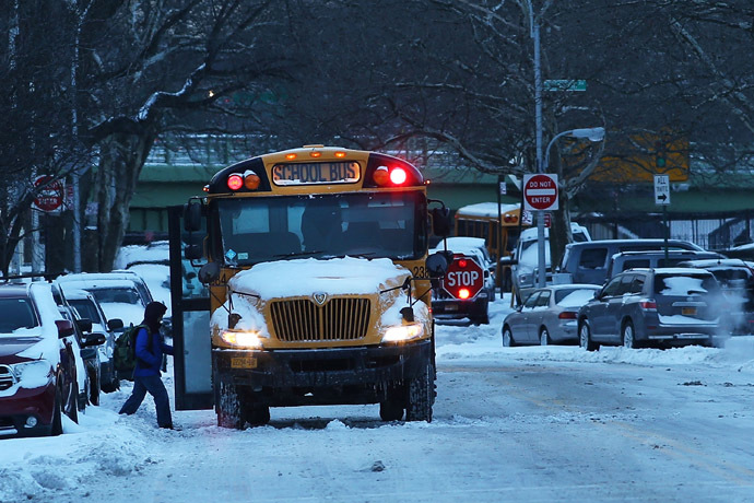A school bus picks up children in Brooklyn on the morning after a major winter storm blanketed much of New York City in 10 to 12 inches of snow on January 22, 2014 in New York City. (Spencer Platt/Getty Images/AFP)