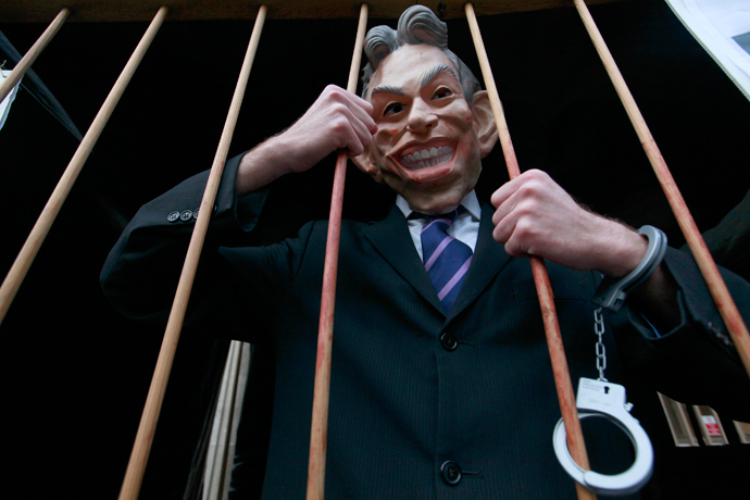 A demonstrator wears a Tony Blair mask outside the Queen Elizabeth II Conference Centre, in central London January 21, 2011. (Reuters / Andrew Winning)