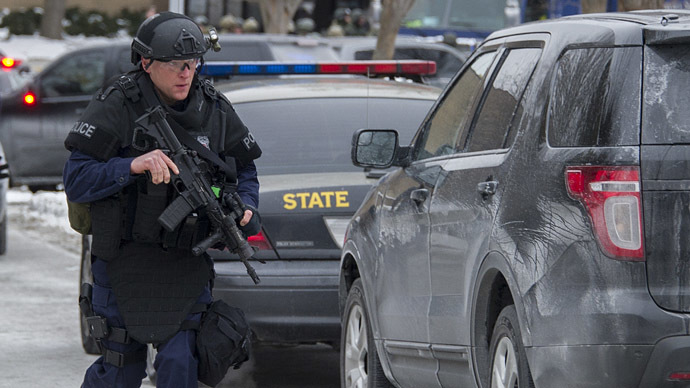 Maryland State Police patrol the Columbia Mall after a fatal shooting on January 25, 2014, in Columbia, Maryland. (AFP Photo/Jim Watson)