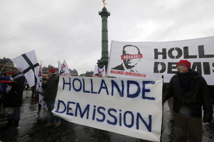 "Demonstrators hold a banner which reads, ""Hollande Resign"" as several thousand people attend the ""Journee de la Colere"" (Day of Anger) march in protest of France's President Francois Hollande, in Paris January 26, 2014. (Reuters/Philippe Wojazer)"