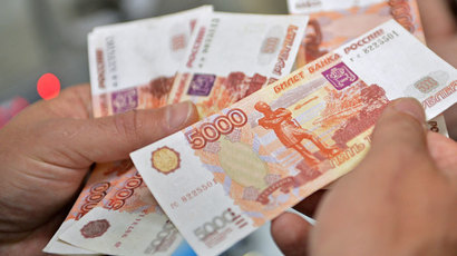 Sliding ruble to drag Russian economy into recession