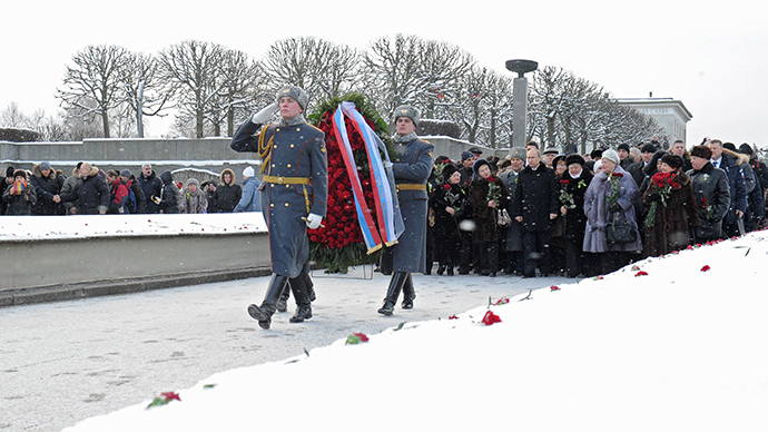 January 27, 2014. Russian President Vladimir Putin, middle ground center, participates in a wreath-laying ceremony at the Motherland memorial at St. Petersburg's Piskaryovskoye Memorial Cemetery. (RIA Novosti / Michael Klimentyev)