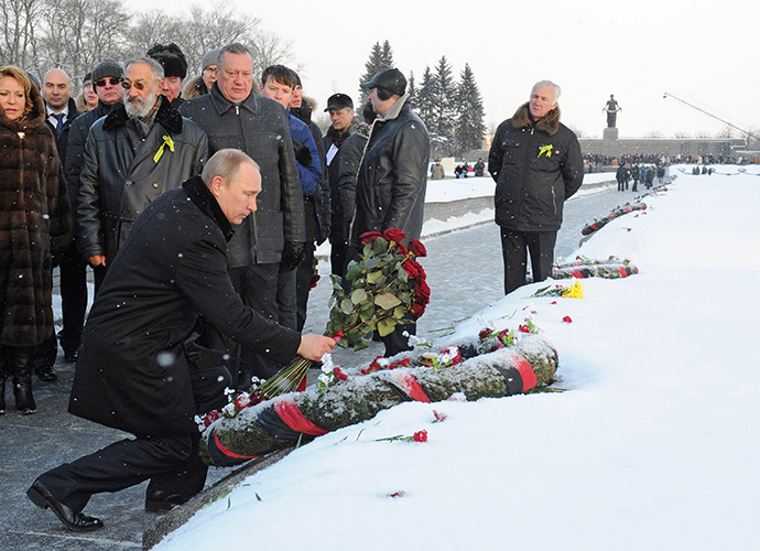 January 27, 2014. Russian President Vladimir Putin, foreground, participates in a wreath-laying ceremony at St. Petersburg's Piskaryovskoye Memorial Cemetery. (RIA Novosti / Michael Klimentyev)