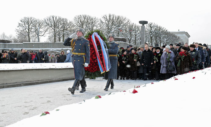 January 27, 2014. Russian President Vladimir Putin, middle ground center, participates in a wreath-laying ceremony at the Motherland memorial at St. Petersburg's Piskaryovskoye Memorial Cemetery.(RIA Novosti / Michael Klimentyev)