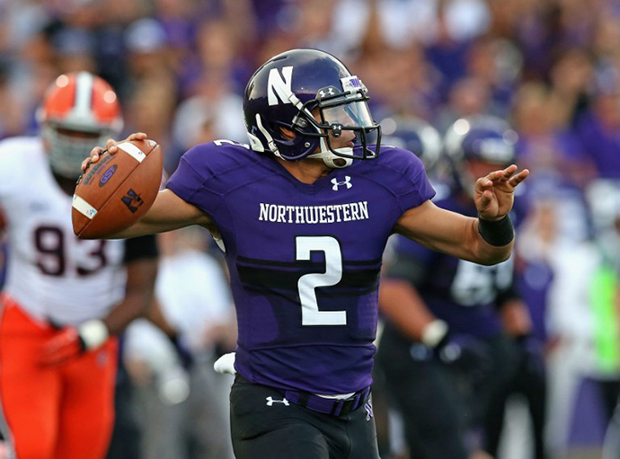 Kain Colter #2 of the Northwestern Wildcats passes against the Syracuse Orange at Ryan Field on September 7, 2013 in Evanston, Illinois. (AFP Photo / Getty Images / Jonathan Daniel)