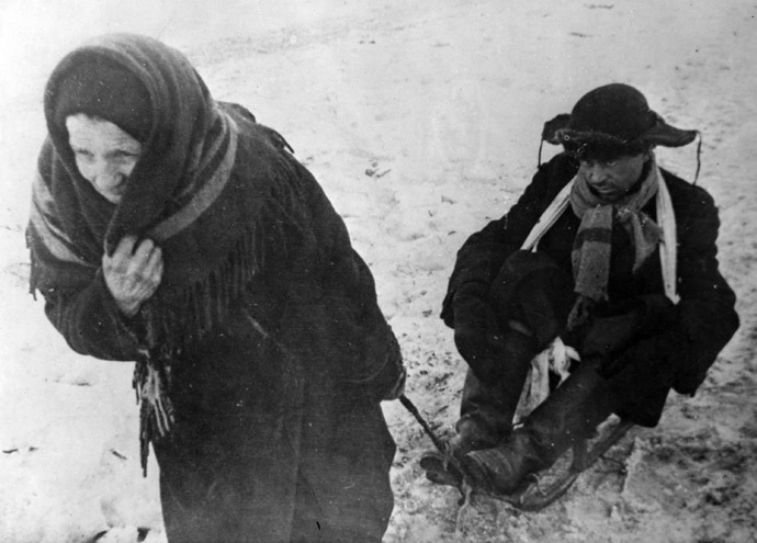 An old woman sledging a starving teenager in besieged Leningrad. (RIA Novosti/Ozersky)