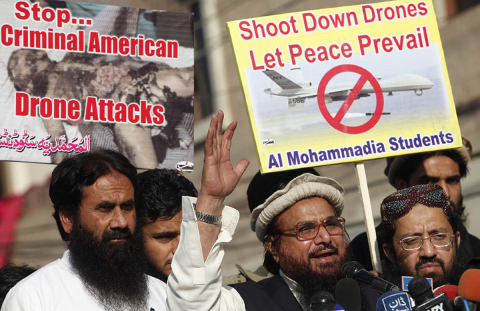 Hafiz Saeed, head of the Jamaat-ud-Dawa organisation and founder of Lashkar-e-Taiba, (2nd R) addresses supporters during a protest against U.S. drone attacks in the Pakistani tribal region, in Lahore November 29, 2013. (Reuters/Mohsin Raza)
