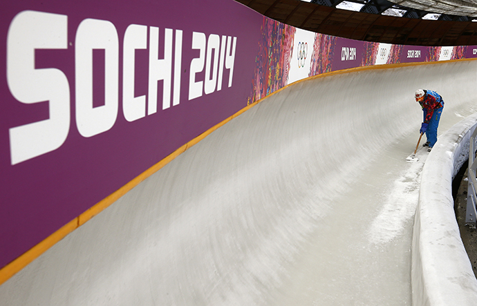 "A worker prepares the ice track at the ""Sanki"" sliding center in Rosa Khutor, a venue for the Sochi 2014 Winter Olympics near Sochi January 31, 2014. (Reuters / Arnd Wiegmann)"