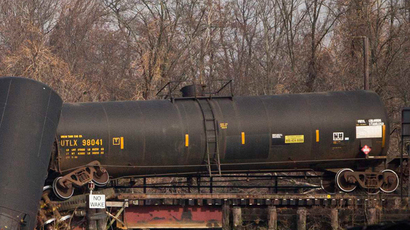 Penn. train derailment leaks thousands of gallons of oil, sends car into building