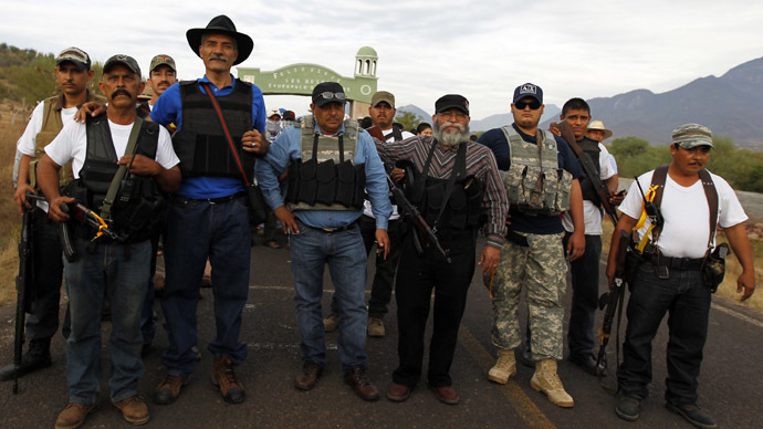​Badges for vigilantes: Mexico gives anti-drug militias official status