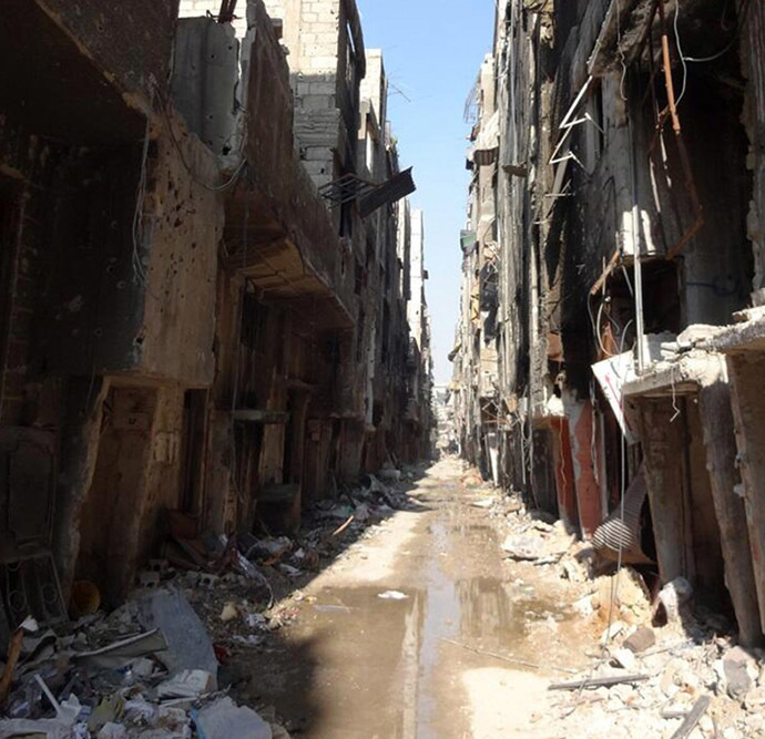 A handout picture released by the United Nations Relief and Works Agency (UNRWA) on January 21, 2014 shows a general view of destruction in Yarmuk Palestinian refugee camp in southern Damascus where the organisation say thousands are trapped and in dire need of aid. (AFP/UNRWA)