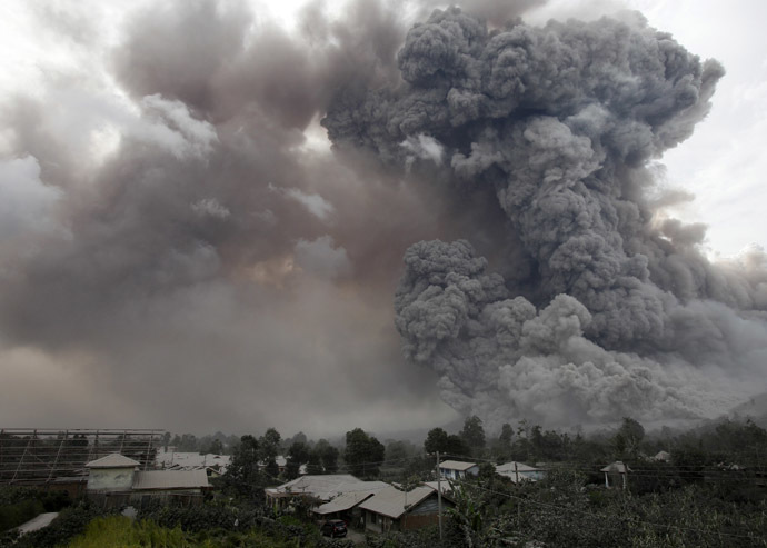 An ash cloud from a Mount Sinabung eruption is seen from Kuta Tengah village in Karo district, Indonesia's North Sumatra province, January 14, 2014. (Reuters)