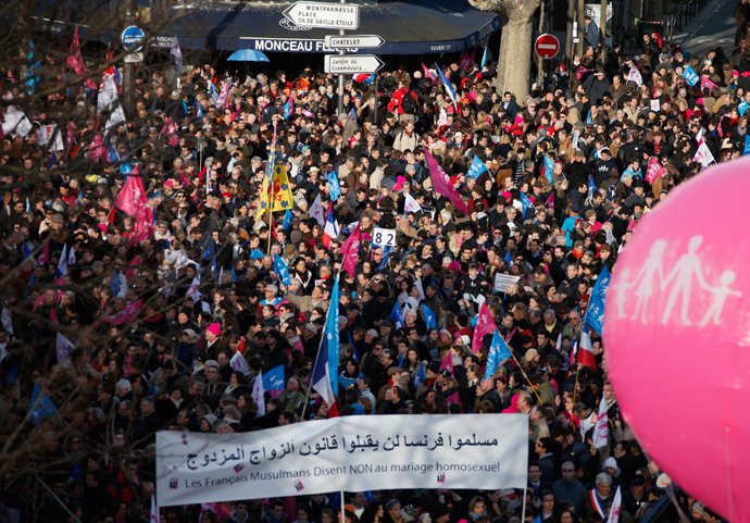 "People wave trademark pink, blue and white flags during a protest march called, ""La Manif pour Tous"" (Demonstration for All) against France's legalisation of same-sex marriage and to show their support of traditional family and education values, in Paris February 2, 2014 (Reuters / Benoit Tessier)"