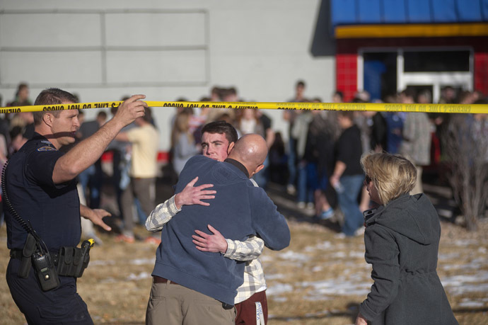 Students gather and reunite with their parents at a fast food joint across from Arapahoe High School, after a student opened fire in the school in Centennial, Colorado December 13, 2013. (Reuters/Evan Semon)