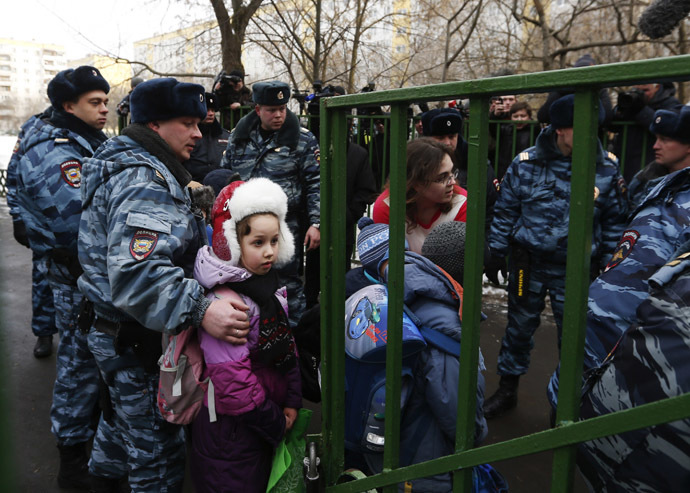 Children walk out of the premises of a high school, where a shooting incident has occurred, on the outskirts of Moscow, February 3, 2014. (Reuters/Maxim Shemetov)
