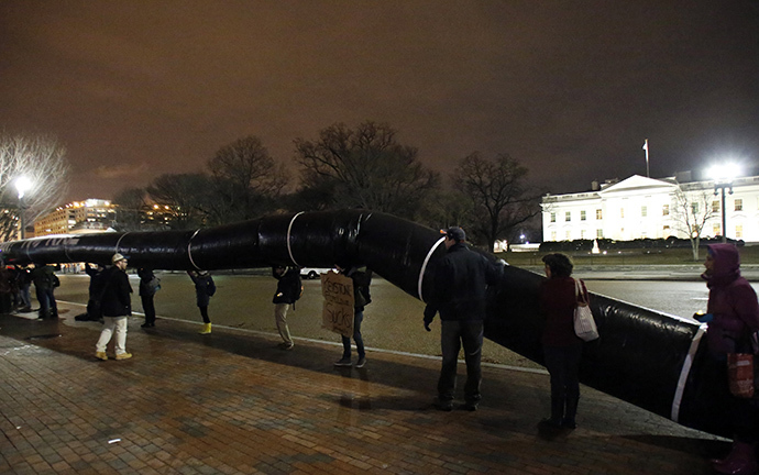 Protesters hold a giant inflated tube during a rally against the Keystone XL oil pipeline outside The White House in Washington February 3, 2014. (Reuters / Yuri Gripas)