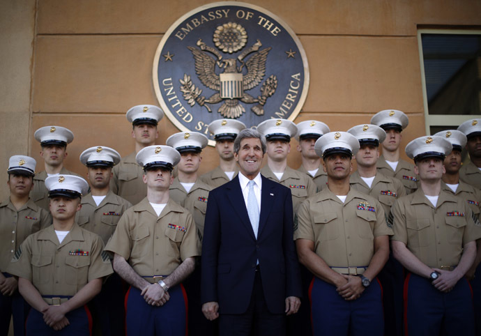U.S. Secretary of State John Kerry (C) poses for a picture with U.S. Marines based in Baghdad during his visit to the U.S. Embassy in Baghdad March 24, 2013. (Reuters/Jason Reed)