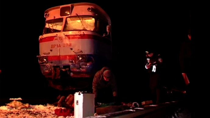 13 killed as commuter train rips apart shuttle bus on crossing in Ukraine