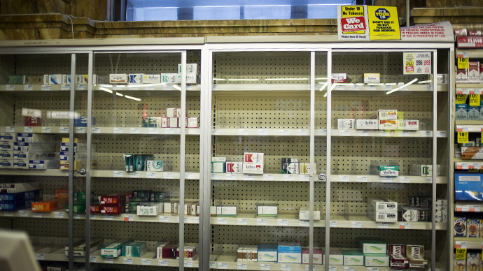 CVS to stop selling tobacco products, set to lose $2 bln