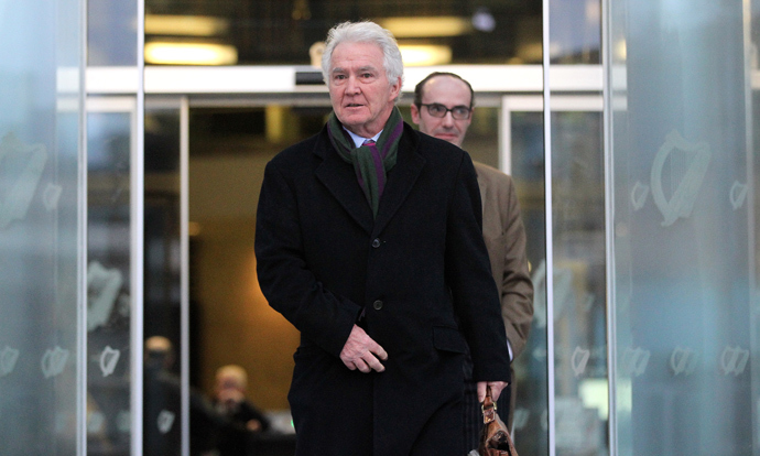 Former chairman and chief executive of Anglo Irish Bank Sean FitzPatrick leaves the Criminal Courts of Justice in Dublin, Ireland on February 5, 2014 after a hearing at the start of his trial. (AFP Photo / Peter Muhly)