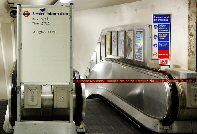 "A service information board states ""No Piccadilly Line"" tube trains during strikes at Green Park underground station in London February 5, 2014. (Reuters / Luke MacGregor)"
