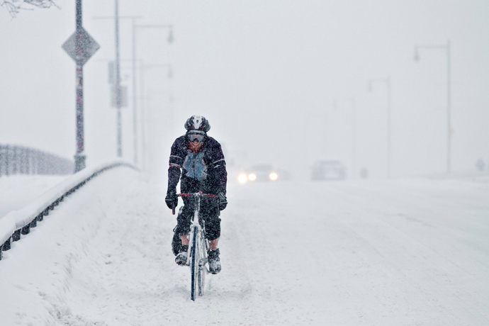 A man rides his bike across a bridge during a winter storm in Boston, Massachusetts, February 5, 2014. (Reuters / Dominick Reuter)