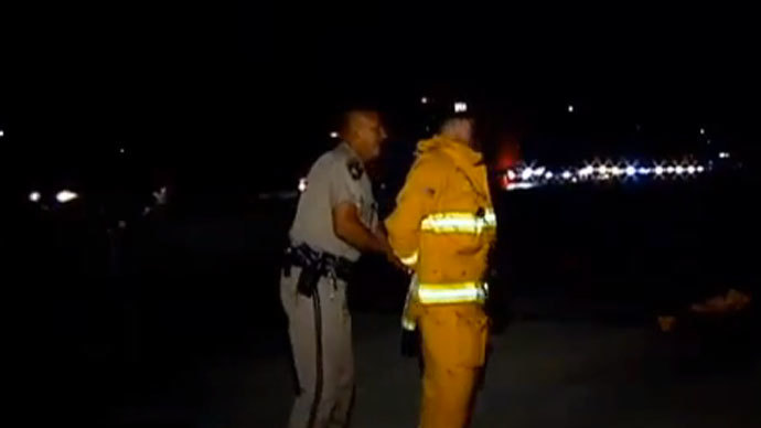 California cop handcuffs and detains firefighter helping crash victims
