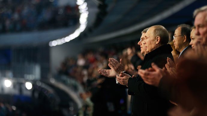 Russian President Vladimir Putin (R) and International Olympic Committee President Thomas Bach applaud during the playing of the Russian national anthem at the opening ceremony of the 2014 Winter Olympics on February 7, 2014, in Sochi.(AFP Photo / David Goldman)