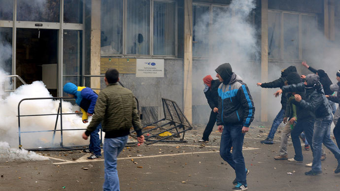 Protesters throw stones at a local government building in the northern Bosnian town of Tuzla, on February 6, 2014.(AFP Photo / Stringer)