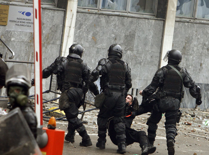 Police detain an anti-government protester in Tuzla February 6, 2014.(Reuters / Stringer)