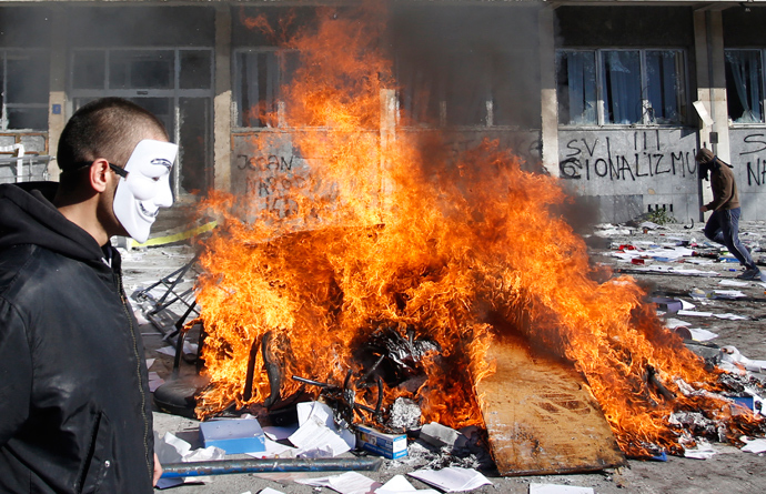 Protesters burn documents from a government building in Tuzla February 7, 2014 (Reuters / Dado Ruvic)