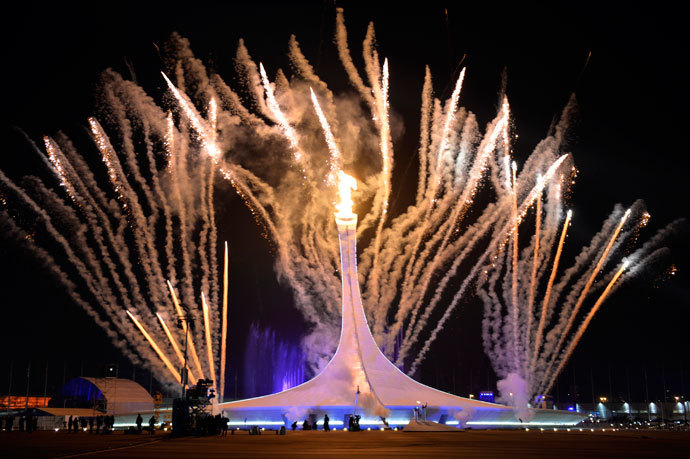 Fireworks explode behind the Olympic flame cauldron during the Opening Ceremony of the Sochi Winter Olympics on February 7, 2014 in Sochi.(AFP Photo / Odd Andersen)
