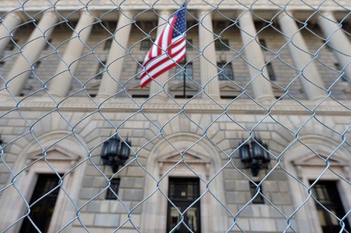 A fence surrounds the U.S. Department of Commerce in Washington October 5, 2013, as the government shutdown continues into the weekend (Reuters / Mike Theiler)