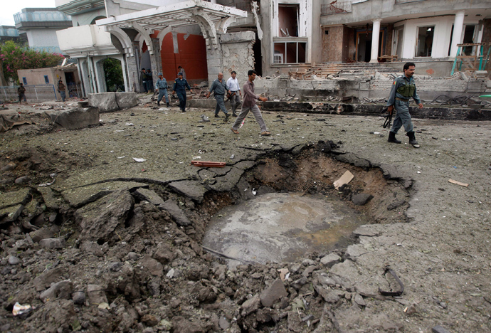 Afghan policemen walk near a crater at the site of a suicide attack at the Indian consulate in Jalalabad province August 3, 2013 (Reuters / Parwiz)