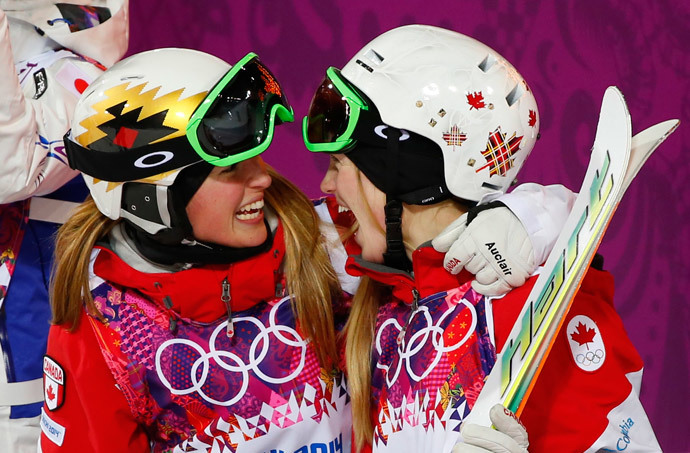 Second-placed Chloe Dufour-Lapointe (L) of Canada congratulates her sister, winner Justine Dufour-Lapointe (R), after the women's freestyle skiing moguls final competition at the 2014 Sochi Winter Olympic Games in Rosa Khutor, February 8, 2014 (Reuters / Mike Blake)