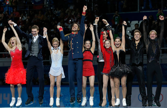 The Russian figure skating team celebrates its gold medal on the podium during the Figure Skating Team Flower Ceremony at the Iceberg Skating Palace during the Sochi Winter Olympics on February 9, 2014.(AFP Photo / Adrian Dennis)