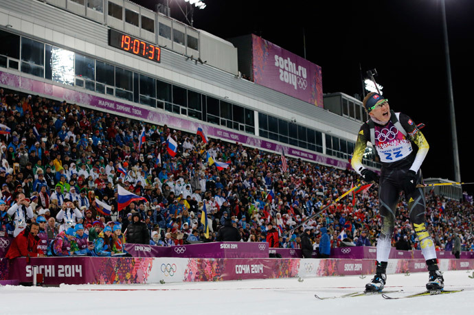 Slovakia's Anastasiya Kuzmina reacts as she crosses the finish line to win the women's biathlon 7.5km sprint event at the 2014 Sochi Winter Olympics February 9, 2014.(Reuters / Carlos Barria)