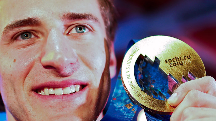 Gold medallist Matthias Mayer of Austria poses with his medal for the men's alpine skiing downhill race, at the Austrian hospitality house during the 2014 Sochi Winter Olympics in Rosa Khutor February 9, 2014. (Reuters / Dominic Ebenbichler)