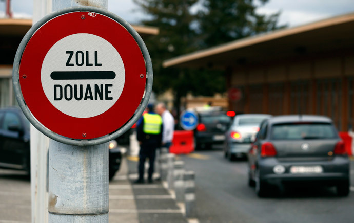 A sign is pictured at the Swiss French border with town of Ferney Voltaire in Le Grand-Saconnex near Geneva February 10, 2014. (Reuters / Denis Balibouse)