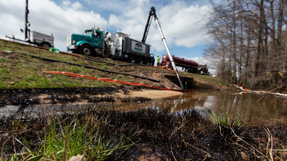 Exxon oil spill town 'deserted land', residents still getting sick, forced to abandon homes